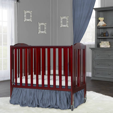 dream on me 2 in 1 folding portable crib features us patented rail system for ease in converting crib to playpen with one hand