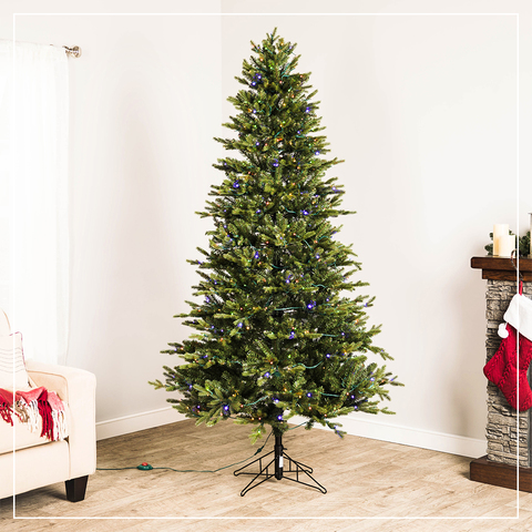 Slender Christmas Splendor The 7-ft tall tree features a slim design that  is perfect for decorating corners or small spaces. - GE 7-ft Pre-lit Ashville Fir Artificial Christmas Tree With 500