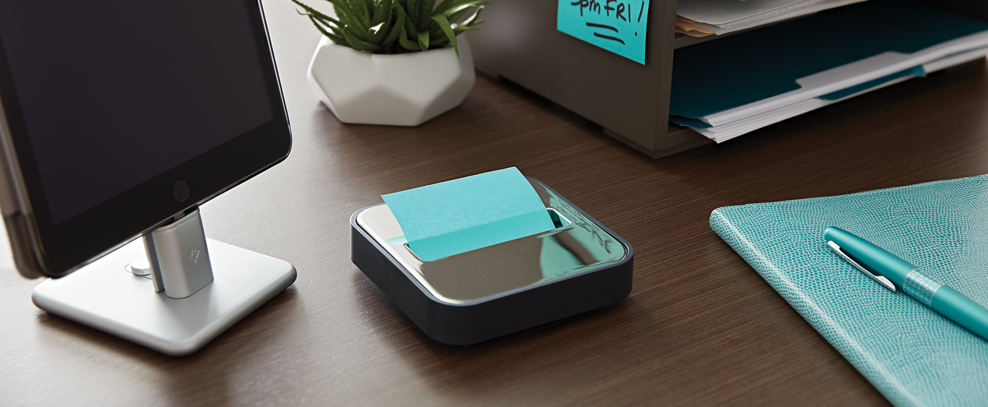 Post-it Pop-up Notes Metal Top Dispenser on desk with notepad and pen