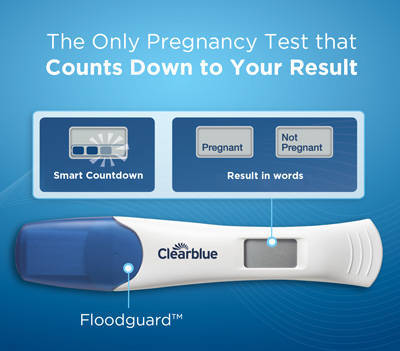 clear blue positive pregnancy test in hand